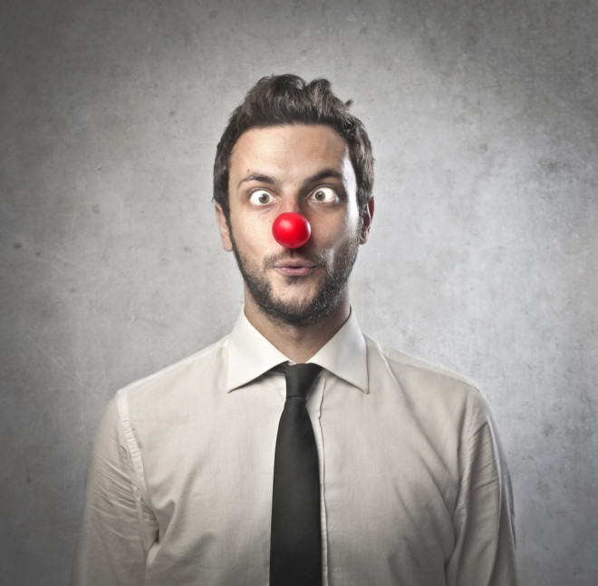 Funny businessman with red plastic nose from shutterstrock.com